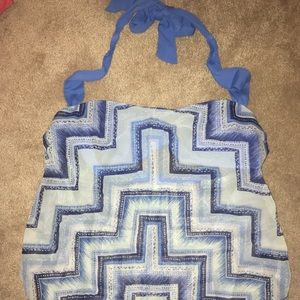 Blue patterned row piece bathing suit.